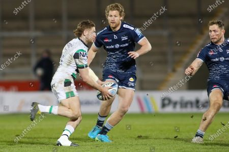 Newcastles Tom Penny runs at Robert Du Preez of Sale during the Gallagher Premiership Rugby match between Sale Sharks and Newcastle Falcons at the AJ Bell Stadium, Eccles