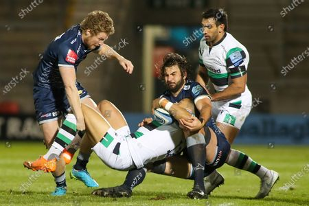 Lood De Jager and Robert Du Preez of Sale tackle Matteo Carreras of Newcastle during the Gallagher Premiership Rugby match between Sale Sharks and Newcastle Falcons at the AJ Bell Stadium, Eccles