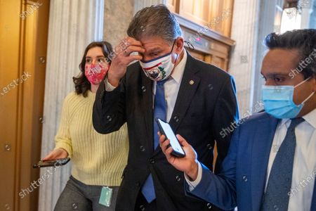 Democratic Senator from West Virginia Joe Manchin responds to a question from the news media as he walks to the Senate floor to vote in the US Capitol in Washington, DC, USA, 05 March 2021. The Senate has started voting on Republican amendments to the Biden administration's $1.9 trillion coronavirus relief package today.