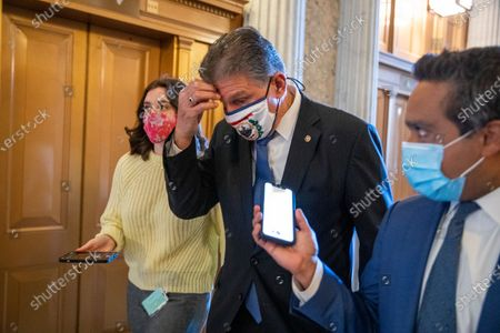 Stock Picture of Democratic Senator from West Virginia Joe Manchin responds to a question from the news media as he walks to the Senate floor to vote in the US Capitol in Washington, DC, USA, 05 March 2021. The Senate has started voting on Republican amendments to the Biden administration's $1.9 trillion coronavirus relief package today.