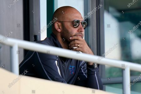Stock Image of Miami Marlins CEO Derek Jeter watches during a spring training baseball game against the Houston Astros, in Jupiter, Fla