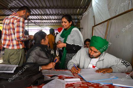 Simranjeet Kaur Gill, 34, lawyer from Mohali, seen assisting farmers at a help desk in Singhu (Delhi-Haryana border), near Delhi, on March 5, 2021 in New Delhi, India.