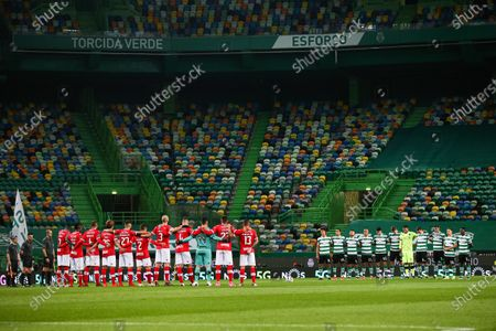 """Stock Picture of Sporting and Santa Clara players hold a minute's silence and pay homage to Maria Jose Valerio, singer of the Sporting hymn who passed away this week, prior to their First League Soccer match held at Alvalade Stadium, in Lisbon, Portugal, 05 March 2021. Maria Jose Valerio was a Portuguese singer, known for her love of Sporting Clube de Portugal and for being the interpreter of the """"Sporting hymn""""."""