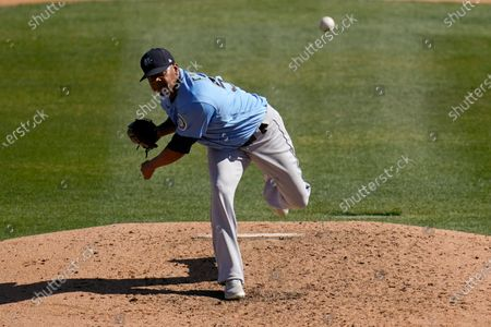Seattle Mariners pitcher Roenis Elias throws to a Chicago White Sox batter during the fourth inning of a spring training baseball game, in Phoenix
