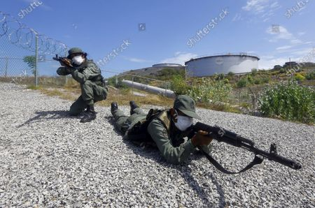Soldiers take part in a military drill near the Puerto La Cruz Refinery, marking the eighth death anniversary of President Hugo Chavez, in Puerto Cabello, Venezuela