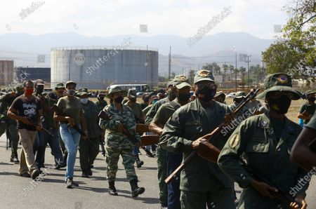 Soldiers patrol near an oil refinery during a military drill to mark the eighth death anniversary of President Hugo Chavez, in Puerto La Cruz, Venezuela
