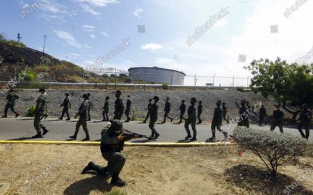 Stock Image of Soldiers take part in a military drill near the Puerto La Cruz Refinery, marking the eighth death anniversary of President Hugo Chavez, in Puerto Cabello, Venezuela