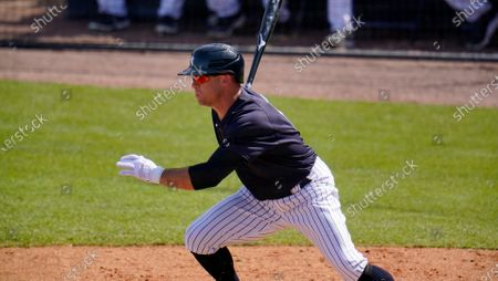 New York Yankees' Brett Gardner bats during a spring training exhibition baseball game against the Detroit Tigers at George M. Steinbrenner Field in Tampa, Fla