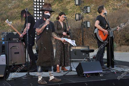 Linda Perry speaks onstage during Rock 'N' Relief, in Los Angeles