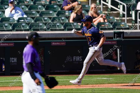 Milwaukee Brewers right fielder Derek Fisher (7) runs the bases after hitting a three-run homer during the fourth inning of a spring training baseball game against the Colorado Rockies, in Scottsdale, Ariz