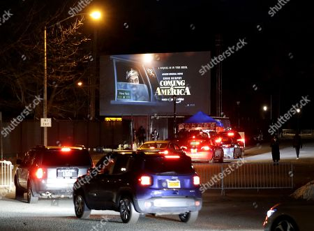 Stock Picture of Cars arrive when the Queens Drive-In 2021 spring season opens with a special screening of Craig Brewer's comedy sequel 'Coming 2 America', starring Eddie Murphy and Arsenio Hall