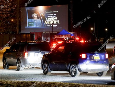 Cars arrive when the Queens Drive-In 2021 spring season opens with a special screening of Craig Brewer's comedy sequel 'Coming 2 America', starring Eddie Murphy and Arsenio Hall