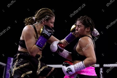 Shelly Barnett, left, lands a punch on Marlen Esparza during a bantamweight bout, in Flint, Mich
