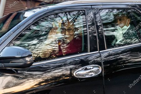 Tibetan spiritual leader the Dalai Lama waves from inside his car as he arrives at the Zonal Hospital to receive a COVID-19 vaccine in Dharmsala, India, . Medical officers confirmed that the Tibetan leader got the Covishield vaccine and is not showing any adverse reaction to the vaccine