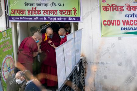 Tibetan spiritual leader the Dalai Lama arrives, helped by two monks, at the Zonal Hospital to receive a COVID-19 vaccine in Dharmsala, India, . Medical officers confirmed that the Tibetan leader got the Covishield vaccine and is not showing any adverse reaction to the vaccine