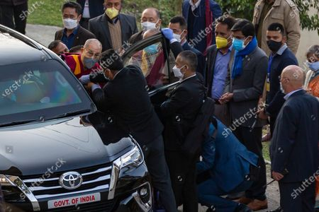 Tibetan spiritual leader the Dalai Lama enters his car as he leaves the Zonal Hospital after receiving a COVID-19 vaccine in Dharmsala, India, . Medical officers confirmed that the Tibetan leader got the Covishield vaccine and is not showing any adverse reaction to the vaccine