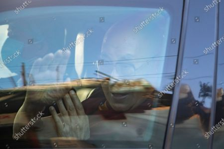 Tibetan spiritual leader the Dalai Lama waves from inside his car as he leaves the Zonal Hospital after receiving a COVID-19 vaccine in Dharmsala, India, . Medical officers confirmed that the Tibetan leader got the Covishield vaccine and is not showing any adverse reaction to the vaccine