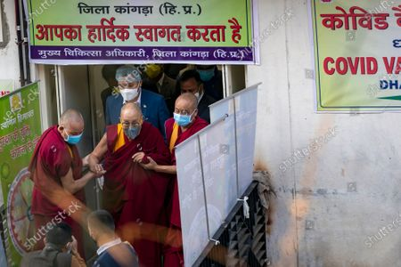 Tibetan spiritual leader the Dalai Lama is helped by two monks as he leaves the Zonal Hospital after receiving a shot of the COVID-19 vaccine in Dharmsala, India, . Medical officers confirmed that the Tibetan leader got the Covishield vaccine and is not showing any adverse reaction to the vaccine