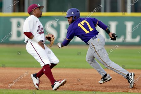 Praire View A&M runner Brayden Johnson, right, scoots past Texas Southern second baseman Tyrese Clayborne, left, as he tries to avoid getting tagged out in a pickle play during an NCAA baseball game, in Houston