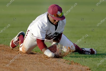 Texas Southern second baseman Tyrese Clayborne traps a line drive hit during an NCAA baseball game against Prairie View A&M, in Houston