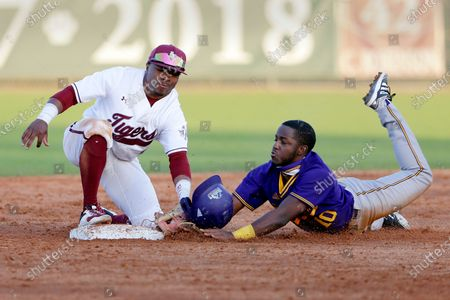 Texas Southern second baseman Tyrese Clayborne, left, makes the tag for the out on the attempted steal by Kellen Rogers, right, during an NCAA baseball game, in Houston