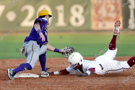 Prairie View A&M's Keanu Maldonado, left, makes the tag for the out on the attempted steal by Texas Southern Tyrese Clayborne, right, during an NCAA baseball game, in Houston