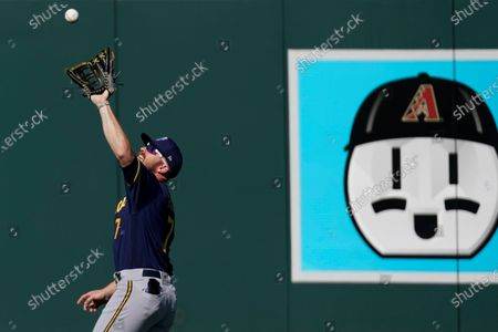 Stock Photo of Milwaukee Brewers right fielder Derek Fisher (7) catches a fly ball during the fifth inning of a spring training baseball game against the Colorado Rockies, in Scottsdale, Ariz