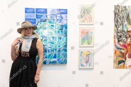 Artist Tatiana Lisovskaya poses with her work. One Art Space in Tribeca held an opening reception for their 5th Annual International Women's Day Art Fair. The exhibition features a diverse, international collection of talent, female-identifying artists of varying ages.