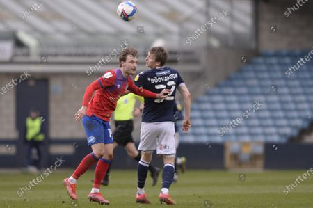 Jon Dadi Bodvarsson of Millwall and Tom Trybull of Blackburn Rovers in action during the Sky Bet Championship, Championship match between Millwall and Preston North End at The Den in London - 6th March 2021