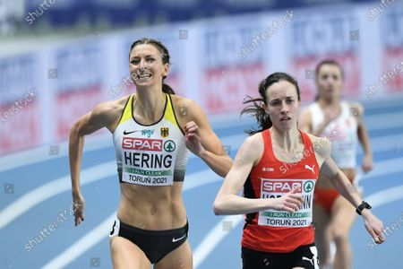Lore Hoffmann (R) of Switzerland and Christina Hering of Germany compete in the women's 800m semifinal at the 36th European Athletics Indoor Championships at the Arena Torun, in Torun, north-central Poland, 06 March 2021.