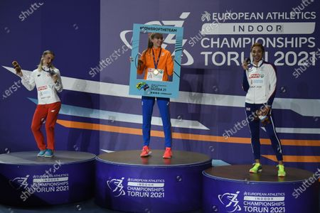 (L-R) Silver medalist Justyna Swiety-Ersetic of Poland, gold medalist Femke Bol of the Netherlands and bronze medalist Jodie Williams of Great Britain celebrate on the podium during the medal ceremony in the women's 400m  at the 36th European Athletics Indoor Championships at the Arena Torun, in Torun, north-central Poland, 06 March 2021.