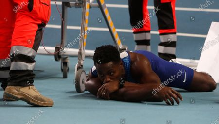 Stock Picture of Britain's Harry Aikines-Aryeetey lies on track after suffering an injury during the men's 60 meters semifinal at the Poland European Indoor Athletics Championships in Torun, Poland