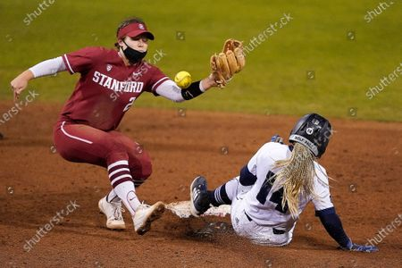 Stock Photo of Stanford's Emily Young (2) can't make the tag as University of Nevada's Sadaria McAlister (14) steals second base during an NCAA softball game on in Stanford, Calif