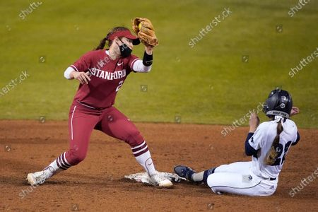University of Nevada's Haley Burda (27) steals second base past Stanford's Emily Young, left, during an NCAA softball game on in Stanford, Calif