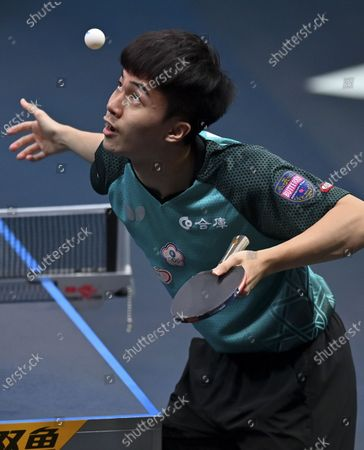 Lin Yun-Ju of Chinese Taipei serves the ball during the men's singles semifinal against Simon Gauzy of France at WTT Contender Doha in Doha, Qatar on March 5, 2021.