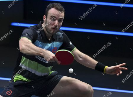 Simon Gauzy of France returns the ball during the men's singles semifinal against Lin Yun-Ju of Chinese Taipei at WTT Contender Doha in Doha, Qatar on March 5, 2021.