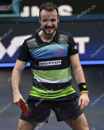 Simon Gauzy of France reacts during the men's singles semifinal against Lin Yun-Ju of Chinese Taipei at WTT Contender Doha in Doha, Qatar on March 5, 2021.