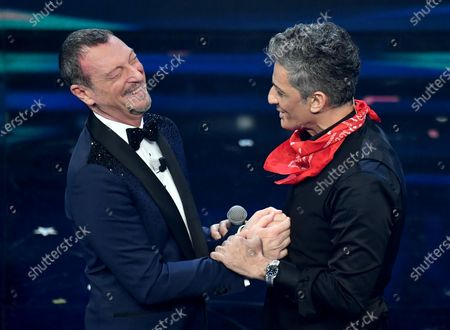 Sanremo Festival host and artistic director, Amadeus, and Italian showman Rosario Fiorello on stage at the Ariston theatre during the 71st Sanremo Italian Song Festival, Sanremo, Italy, 06 March 2021. The festival runs from 02 to 06 March.