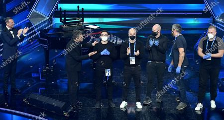 Sanremo Festival host and artistic director, Amadeus and Italian showman Rosario Fiorello with the entertaiment workers on stage at the Ariston theatre during the 71st Sanremo Italian Song Festival, Sanremo, Italy, 06 March 2021. The festival runs from 02 to 06 March.