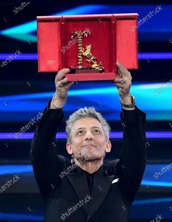 Italian showman Rosario Fiorello receives the 'Citta' di Sanremo' award on stage at the Ariston theatre during the 71st Sanremo Italian Song Festival, Sanremo, Italy, 06 March 2021. The festival runs from 02 to 06 March.