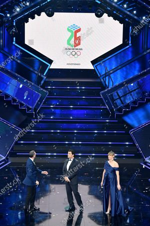 Stock Picture of Sanremo Festival host and artistic director, Amadeus, Former Italian ski racer Alberto Tomba and Olympic Italian swimmer Federica Pellegrini on stage at the Ariston theatre during the 71st Sanremo Italian Song Festival, Sanremo, Italy, 06 March 2021. The festival runs from 02 to 06 March.