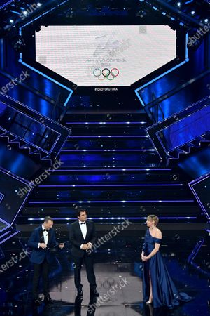 Sanremo Festival host and artistic director, Amadeus, Former Italian ski racer Alberto Tomba and Olympic Italian swimmer Federica Pellegrini on stage at the Ariston theatre during the 71st Sanremo Italian Song Festival, Sanremo, Italy, 06 March 2021. The festival runs from 02 to 06 March.