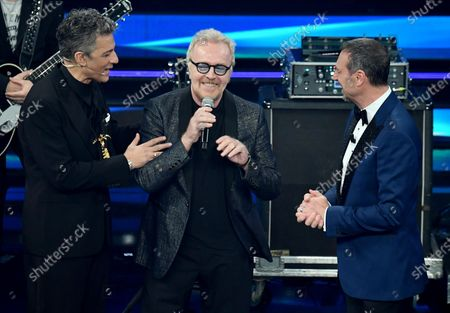 Sanremo Festival host and artistic director, Amadeus, and Italian showman Rosario Fiorello with Italian singer Umberto Tozzi on stage at the Ariston theatre during the 71st Sanremo Italian Song Festival, Sanremo, Italy, 06 March 2021. The festival runs from 02 to 06 March.