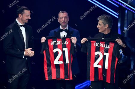 Milan's Swedish forward Zlatan Ibrahimovic, Sanremo Festival host and artistic director, Amadeus and Italian showman Rosario Fiorello  on stage at the Ariston theatre during the 71st Sanremo Italian Song Festival, Sanremo, Italy, 06 March 2021. The festival runs from 02 to 06 March.