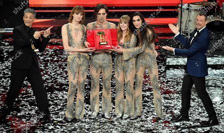 Sanremo Festival host and artistic director, Amadeus (R), and Italian showman Rosario Fiorello (L) stand with Italian band Maneskin while they pose with the prize after winning the 71st Sanremo Italian Song Festival, Sanremo, Italy, 06 March 2021.