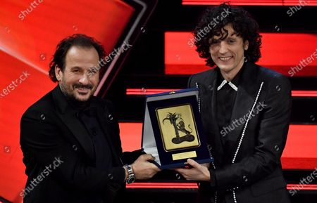 Ermal Meta (R) receives the trophy from Italian conductor Leonardo de Amicis (L), after winning the 'Giancarlo Bigazzi' prize on stage at the Ariston theatre during the 71st Sanremo Italian Song Festival, Sanremo, Italy, 06 March 2021.