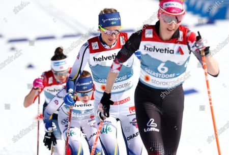 Sweden's Frida Karlsson, second right, competes during the WSC Women's Mass Start 30km Classic cross country event at the FIS Nordic World Ski Championships in Oberstdorf, Germany