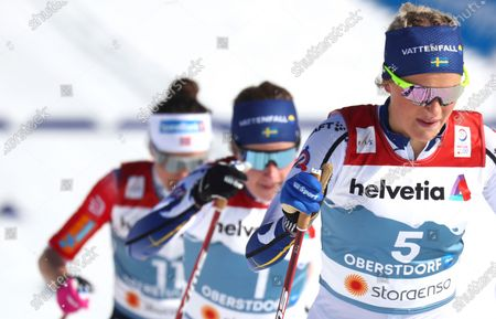 Sweden's Frida Karlsson, right, competes during the WSC Women's Mass Start 30km Classic cross country event at the FIS Nordic World Ski Championships in Oberstdorf, Germany