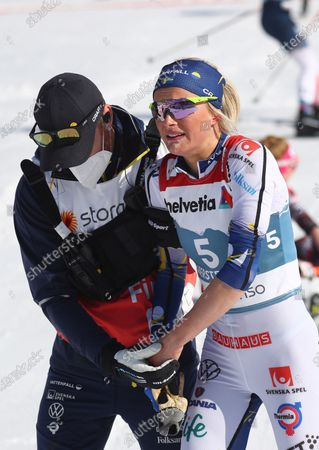 Sweden's Frida Karlsson reacts at the finish line during the WSC Women's Mass Start 30km Classic cross country event at the FIS Nordic World Ski Championships in Oberstdorf, Germany