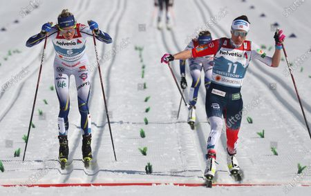Norway's Heidi Weng, right, crosses the finish at the finish line to take second place followed by Sweden's Frida Karlsson, left, during the WSC Women's Mass Start 30km Classic cross country event at the FIS Nordic World Ski Championships in Oberstdorf, Germany